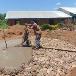 The Water Project: Mukama Primary School -  Pouring Concrete Tank Foundation