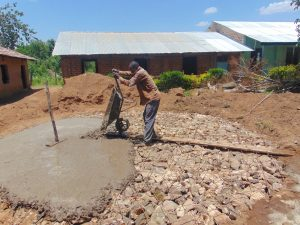 The Water Project:  Pouring Concrete Tank Foundation
