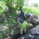 The Water Project: Buyangu Community, Mukhola Spring -  Digging Drainage Channel