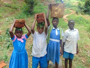 The Water Project:  Kids Help Deliver Construction Materials