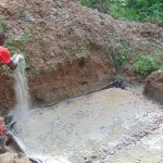 The Water Project: Kimarani Community, Kipsiro Spring -  Adding To The Foundation