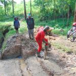 The Water Project: Kimarani Community, Kipsiro Spring -  Laying The Concrete Foundation