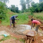 The Water Project: Shikhombero Community, Atondola Spring -  Mixing Concrete