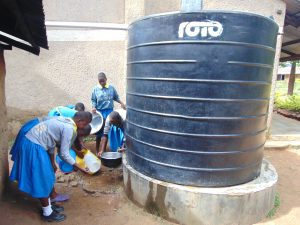 The Water Project:  Students Wash Dishes At Plastic Tank