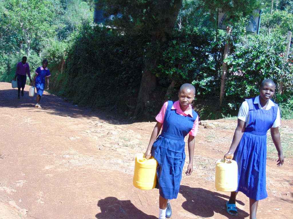 The Water Project : 20-kenya20149-students-carry-water-to-school