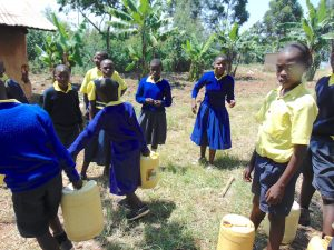 The Water Project:  Pupils Bring Water To Kitchen