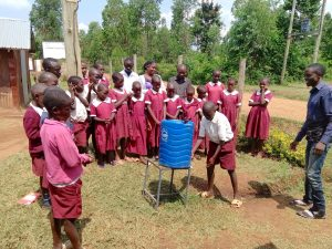 The Water Project:  Student Tries Out The Handwashing Station