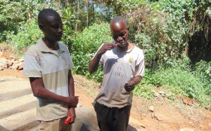 The Water Project:  A Man Demonstrates Toothbrushing Next To Trainer Amos