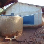 The Water Project: Kitagwa Secondary School -  Small Plastic Rain Tank Cased In Cement