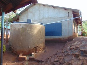 The Water Project:  Small Plastic Rain Tank Cased In Cement