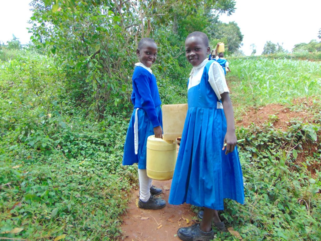 The Water Project : 21-kenya20140-pupils-sharing-water-on-way-from-spring