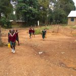 The Water Project: Wavoka Primary School -  Students Carrying Water