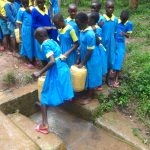 The Water Project: Isikhi Primary School -  Pupils Fetching Water