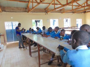 The Water Project:  Students Take Notes At Training