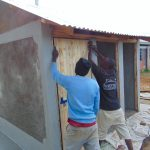 The Water Project: Mukama Primary School -  Fitting A Latrine Door