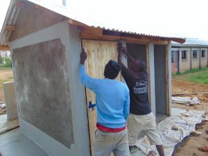 The Water Project:  Fitting A Latrine Door