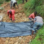 The Water Project: Malimali Community, Shamala Spring -  Adding Plastic Tarp