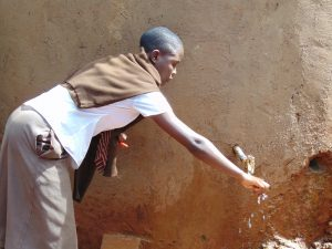 The Water Project:  Student Draws Water From The Small Tank