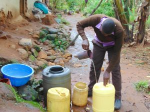 The Water Project:  Student Collects Water At Home