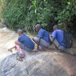 The Water Project: Mwikhupo Primary School -  Students Fetching Water