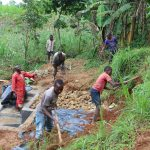 The Water Project: Malimali Community, Shamala Spring -  Backfilling With Soil