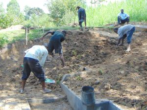 The Water Project:  Backfilling With Soil Over Tarp