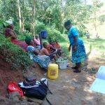 The Water Project: Bumira Community, Imbwaga Spring -  Karen Advises Against Putting Leaves In Buckets With Water