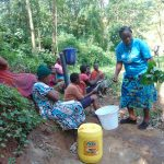 The Water Project: Bumira Community, Imbwaga Spring -  Leave Leaves Out Of The Water Says Karen