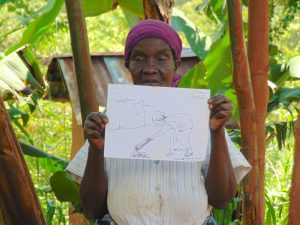 The Water Project:  Woman Holding Training Materials