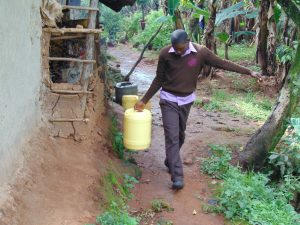 The Water Project:  Student Carrying Water From Home