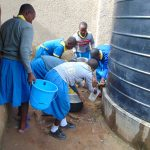 The Water Project: Shikomoli Primary School -  Students Collecting Water