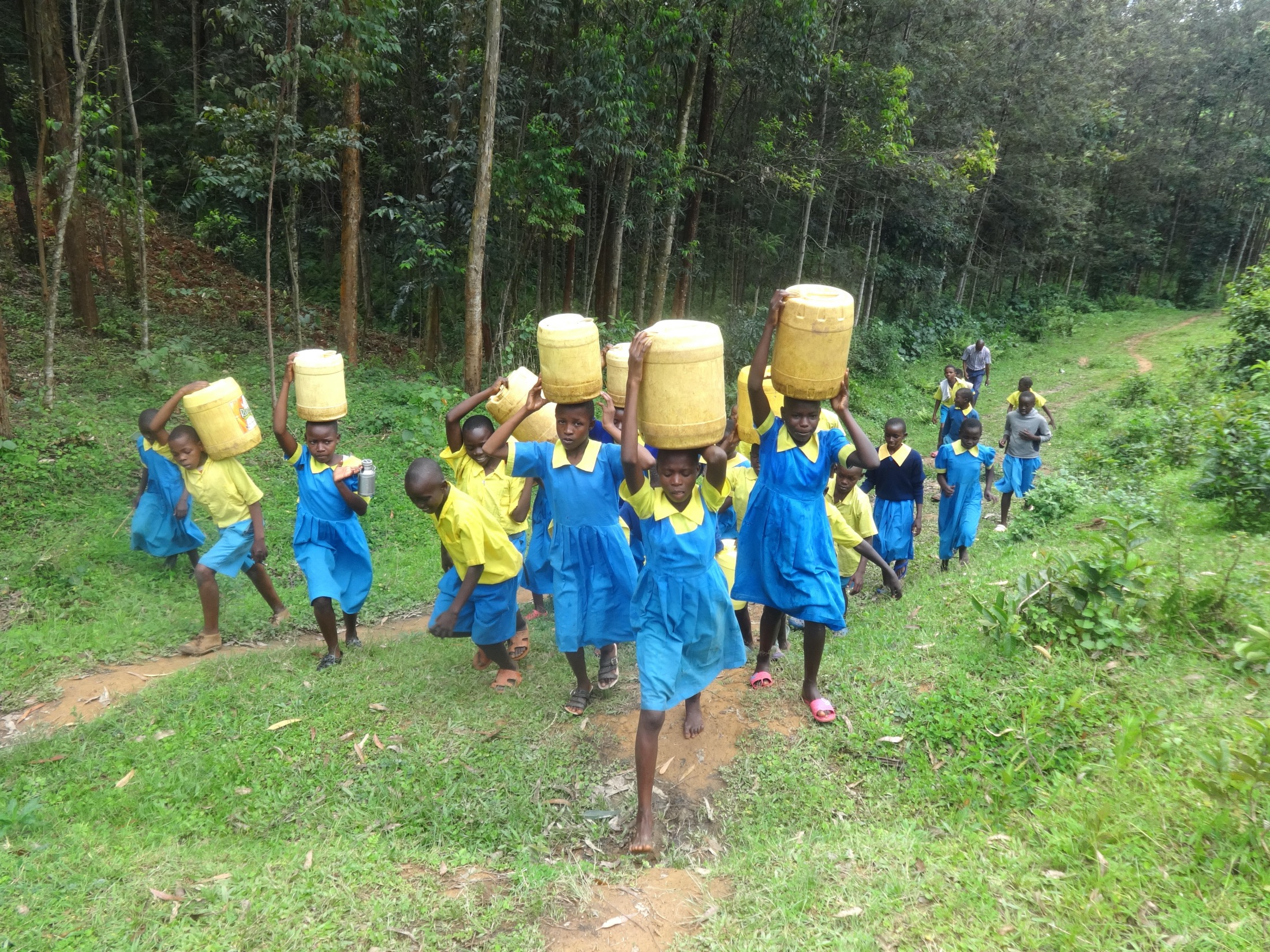 The Water Project : 23-kenya20146-pupils-carrying-water-back-to-school