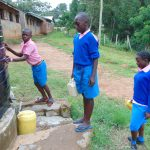 The Water Project: St. Joaim Buyangu Primary School -  Pupils Fetching Water