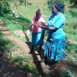 The Water Project: Bumira Community, Imbwaga Spring -  Karen Demonstrates Handwashing