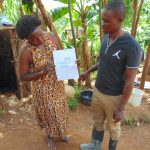 The Water Project: Kimarani Community, Kipsiro Spring -  Using Training Materials