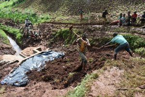 The Water Project:  Adding Soil Over The Tarp