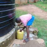 The Water Project: St. Joaim Buyangu Primary School -  Pupil Fetching Water