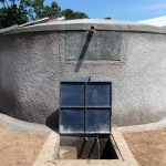 The Water Project: Kosiage Primary School -  Clean Water Flows From Completed Rain Tank