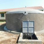 The Water Project: Mulwanda Mixed Primary School -  Clean Water Flows From The New Rain Tank
