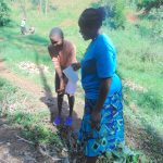 The Water Project: Bumira Community, Imbwaga Spring -  Handwashing Demonstration