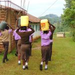 The Water Project: Friends Musiri Secondary School -  Students Carrying Water To School