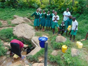 The Water Project:  Waiting For A Community Member To Fetch Water