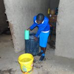 The Water Project: St. Joaim Buyangu Primary School -  Pupil Collects Water At Home