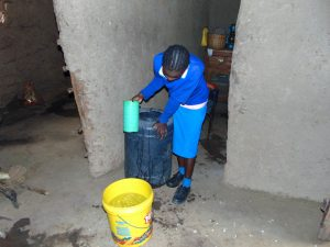 The Water Project:  Pupil Collects Water At Home