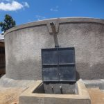 The Water Project: Mwichina Primary School -  Clean Water Flows From Newly Completed Rain Tank