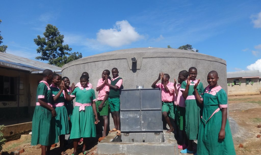 The Water Project : 25-kenya19063-pupils-celebrate-the-new-rain-tank