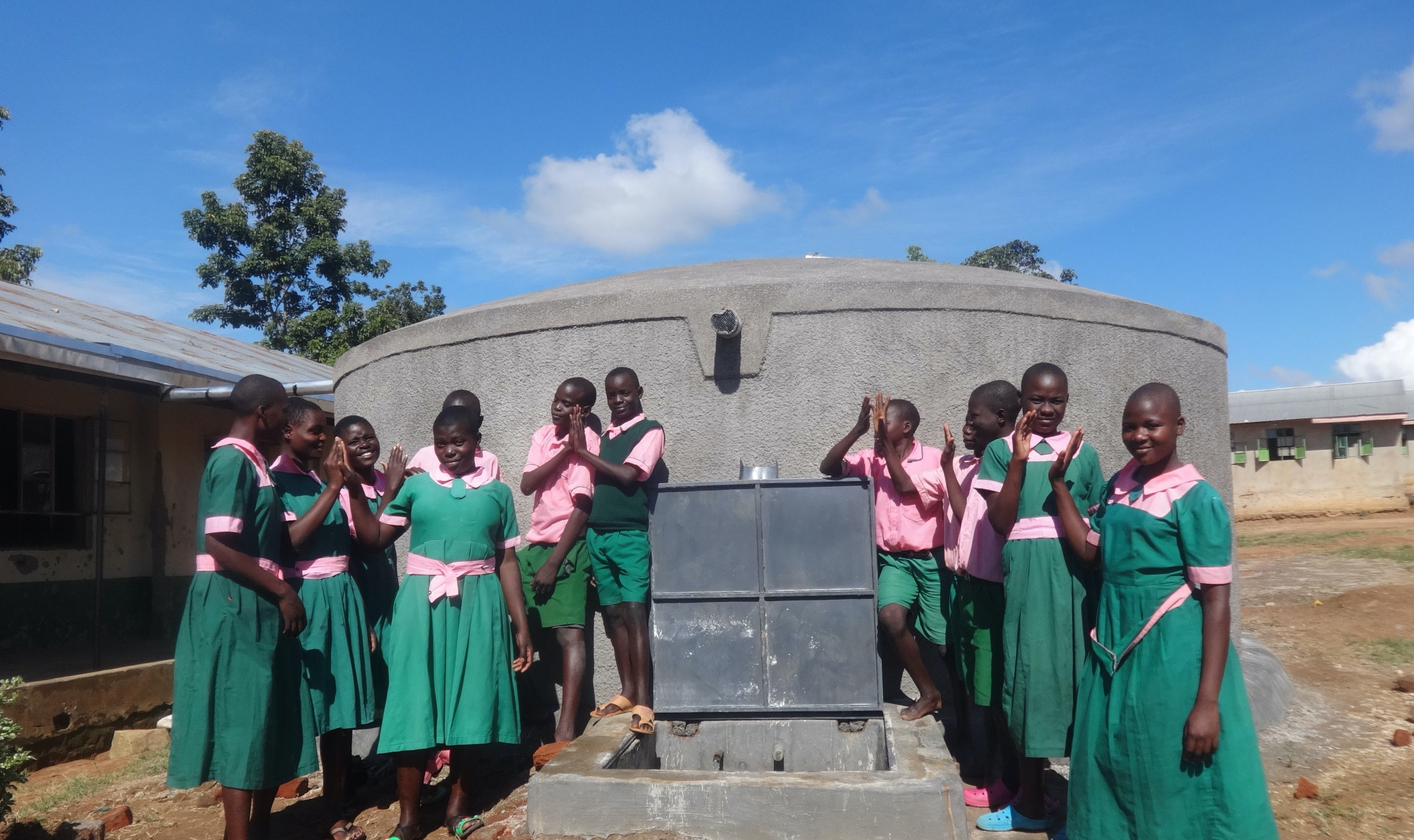 The Water Project : 25-kenya19063-pupils-celebrate-the-new-rain-tank