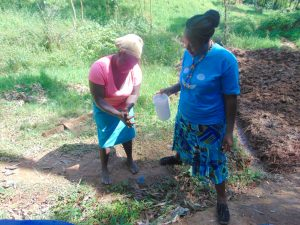The Water Project:  A Volunteer Demonstrates Handwashing
