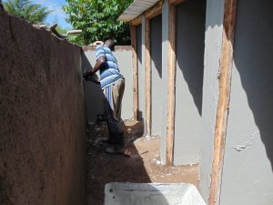 The Water Project:  Plastering A Latrine Block