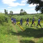 The Water Project: Mwikhupo Primary School -  Students Carrying Water